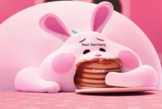 розовый заяц ест блины