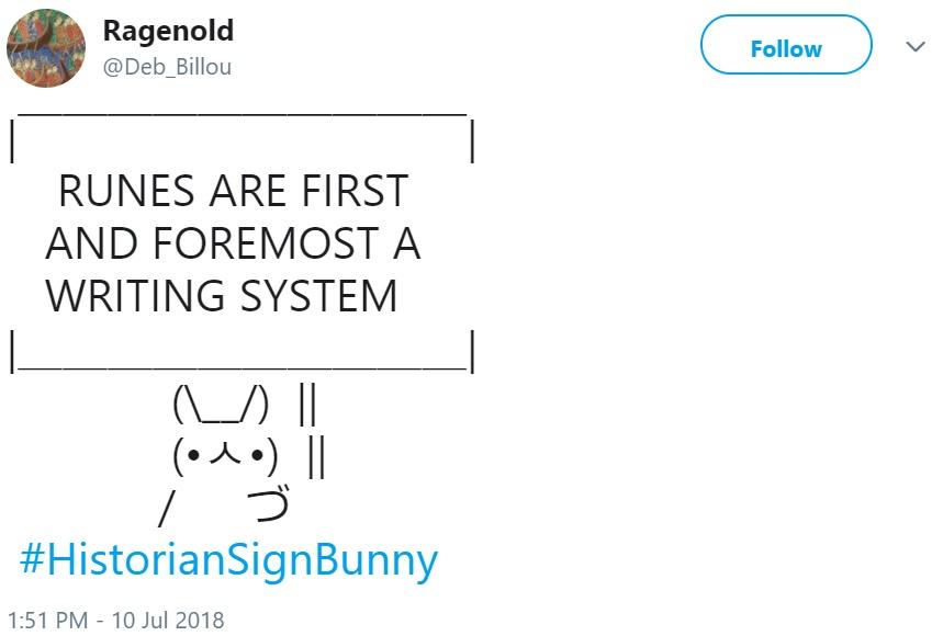 Кролик с плакатом