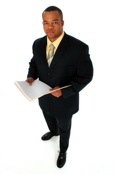 Handsome African American business man dressed in a black suit