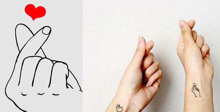 жест пальцем под носом и показать сердечко